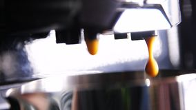 Macro Slow Motion Side View Coffee Drops Fall down. In shining metal cup against flow background stock footage