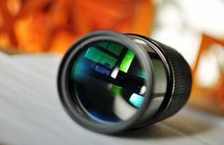 Macro of a slr camera zoom lens reflecting window. Close up macro image of the front of a slr camera zoom lens with a rather abstract view of an old antique Royalty Free Stock Photography