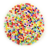 Macro of small glass beads in assorted colors Stock Photo