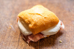 Macro of small sandwich with ham and mozzarella. On a wooden cutting board Stock Photos