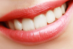 Macro smile. Close-up happy female smile with healthy white teeth Stock Photos