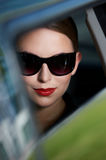 Macro Smiling Face Inside A Car Royalty Free Stock Photo