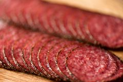Macro of smoked salami sausage background. Top view, copy space. Sliced salami texture close up Royalty Free Stock Photography