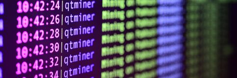 Macro snapshot of the program interface for crypto currency mining on the monitor of an office computer. The concept of mining bit. Coins. The flow of stock photos