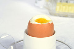 Macro soft boiled brown egg. With a spoon Royalty Free Stock Photos