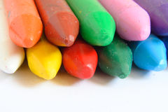 Macro of some colored wax crayons on a white background. Stock Images