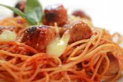 Macro spaghetti and Meatballs. Spaghetti, meat sauce and a meatball in a bowl. Garnished with parsley and shredded Parmesan cheese Stock Images