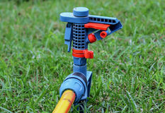 Macro sprinkler off on green lawn Stock Photos