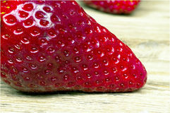 Macro strawberry on wooden table Royalty Free Stock Image