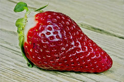 Macro strawberry on wooden table Royalty Free Stock Photos