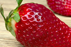 Macro strawberry on wooden table Stock Photography