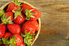 Macro of sweet strawberries on wooden background with copyspace Royalty Free Stock Image