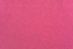 Velvet fabric of pink color. Macro texture of fabric of a velvet of pink color for an abstract background or for wallpaper Royalty Free Stock Images