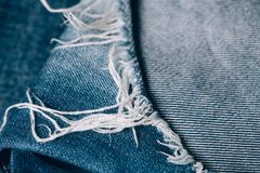Macro texture of jeans hole and threads. Close up stock photos
