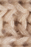 Macro texture of knitted beige scarf Stock Image