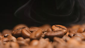 MACRO: Thin aroma over a coffee beans Royalty Free Stock Photo