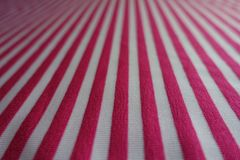 Macro of striped fabric in pink and white. Macro of thin striped fabric in pink and white Royalty Free Stock Photography