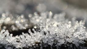 Macro time-lapse of melting hoarfrost particles. Majestic beauty of springtime transformation in wildlife nature. Melting Snow. Melting Ice. Melting Iceberg stock footage