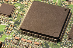 Macro of a tiny but powerful microchip mounted on a circuit board Royalty Free Stock Image