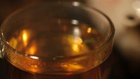 Macro of transparent teacup with hot herbal tea. stock video footage