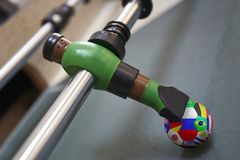 Macro of a unity in a foosball table flagged with country flag. Colombia flag royalty free stock images