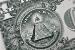 Macro of US Dollar bill. Macro image of US Dollar bill focused on the eye. Added zoom blur for effect Stock Photo