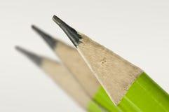 Macro van een groen potlood wordt geschoten dat Stock Afbeeldingen