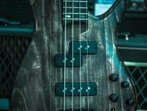 Macro van elektrische gitaar, houten oppervlakte wordt geschoten die stock afbeelding