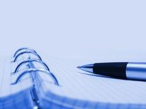 Macro van pen en notitieboekje stock afbeeldingen