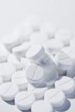 Macro van witte pillen stock afbeeldingen