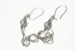 Macro van zilveren oorringen Stock Afbeeldingen
