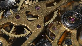 Macro video of an old pocket watch movement. Close up stock video footage