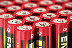 Macro view of AA batteries. Macro view of group of red AA size 1.5 volts cell batteries with selective focus effect royalty free illustration