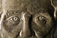 Macro View of Abraham Lincoln`s Eyes on Dollar Coin stock image