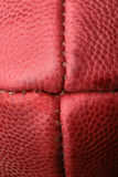 Macro View of An American Football. Macro view of a American football. Upclose vertical view of brown leather pigskin, football Royalty Free Stock Photography