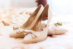 Bride wedding shoes. Macro view of the beautiful fashionable white bride wedding shoes with selective focus effect stock photos