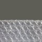 Macro view bubble wrap package. Transportation equipment concept. Copy space, gray background Royalty Free Stock Photos