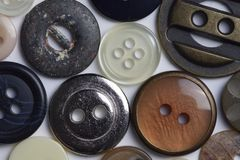 Macro view of buttons and fasteners with assorted colors and textures royalty free stock image