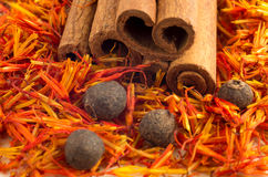 Macro view of the cinnamon, peppercorn and saffron Royalty Free Stock Images