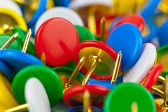 Macro view of color pushpins. Office life background: macro view of color pushpins Stock Photos