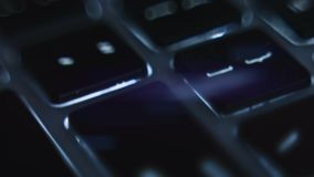 Macro view of computer keyboard with blue light. Small depth of field. stock video footage