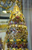 Macro view of gold, diamond and jewels. In Myanmar Buddhist temple stock image