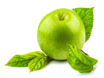 Green apple with green leaves. Macro view of green apple with green leaves isolated on white background Stock Image