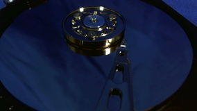 Macro view of hard disk head movements. stock footage