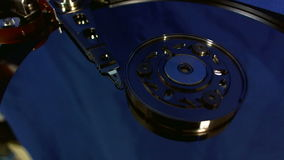 Macro view of hard disk head movements. stock video