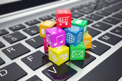 Macro view of heap  colorful cubes with application icons and symbols on laptop keyboard  depth  field effect. 3d Stock Photos