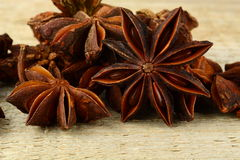 Macro view of many anise on wooden board Stock Photos