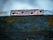 Old wood with rusty metal element. Macro view of old rustic and weathered part of door or wall with rusty metal element stock photos
