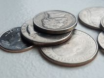 Stack of US coins currency in closeup Liberty dime and quarters stock photography