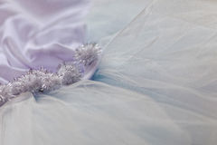 Macro view of sewing dresses. Close Up of fabric mesh for Tutu. Children`s dance skirt. Net wedding textile Royalty Free Stock Image